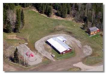 Bearberry Community Ground. Picture is courtesy of Petro Canada. It shows the Heritage & Arts Centre, Community Hall, Playground and Campground